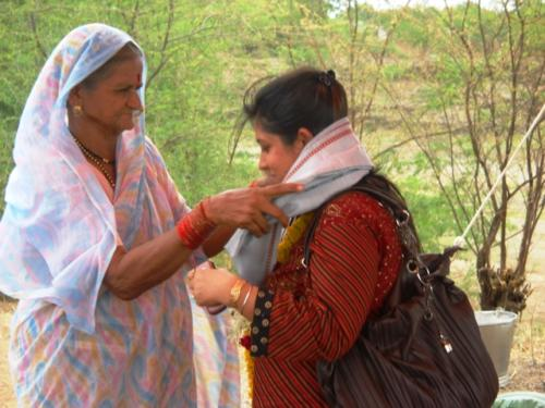 Ms.Shalini getting honoured by an Elderly Woman from the Village